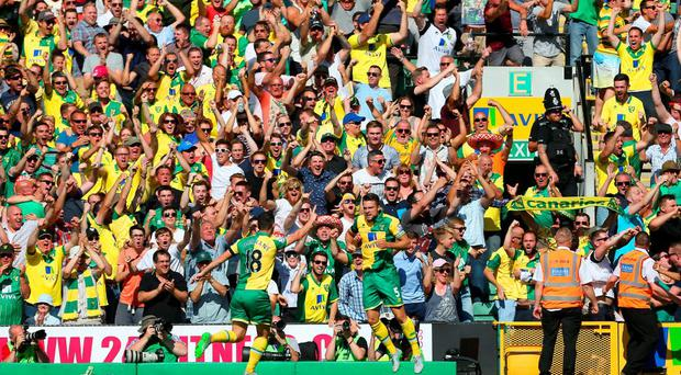 Norwich City's Russell Martin celebrates scoring the equaliser against Stoke City at Carrow Road