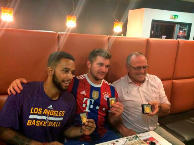 In this photo made early Saturday, Aug. 22, 2015, image obtained from the Facebook webpage of the mayor of Arras, Fredric Leturque, sits with passengers of the Thalys train who subdued a gunman as they display their medal after being awarded by the mayor of Arras, northern France, with left to right, Anthony Sadler, a senior at Sacramento State University, Alek Skarlatos, US National Guardsman from Roseburg, Oregon, Briton Chris Norman. (Arras City Hall via AP) MANDATORIT CREDIT