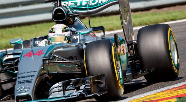 Mercedes driver Lewis Hamilton steers his car to set the pole position during the qualifying session at the Spa-Francorchamps