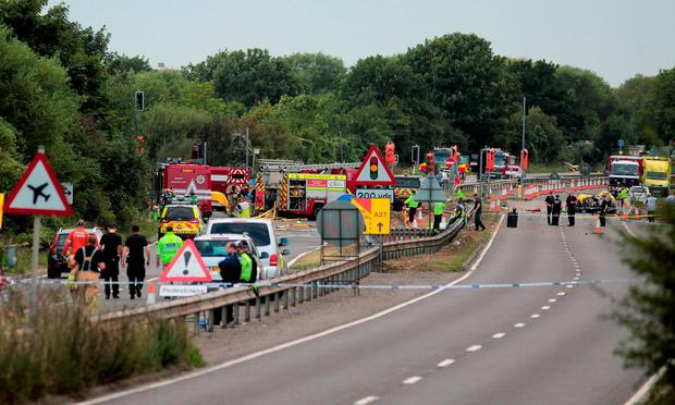 Emergency services attend the scene on the A27 as seven people have died after a plane crashed into cars on the major road during an aerial display at the Shoreham Airshow in West Sussex. Daniel Leal-Olivas/PA Wire