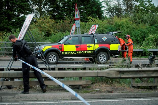 A Search and Rescue team attends the scene on the A27 as seven people have died after a plane crashed into cars on the major road during an aerial display at the Shoreham Airshow in West Sussex. Daniel Leal-Olivas/PA Wire