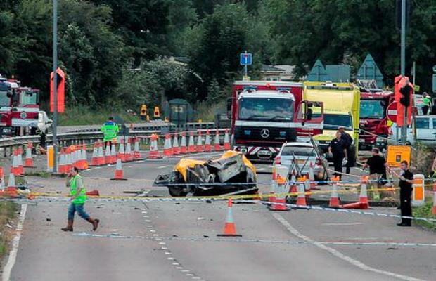 Emergency services attend the scene on the A27 as seven people have died after a plane crashed into cars on the major road during an aerial display at the Shoreham Airshow in West Sussex. PRESS ASSOCIATION Photo. Picture date: Saturday August 22, 2015. See PA story AIR Crash. Photo credit should read: Daniel Leal-Olivas/PA Wire