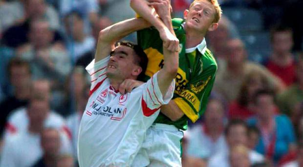 Tyrone's Ryan McMenamin in action against Kerry's Colm Cooper