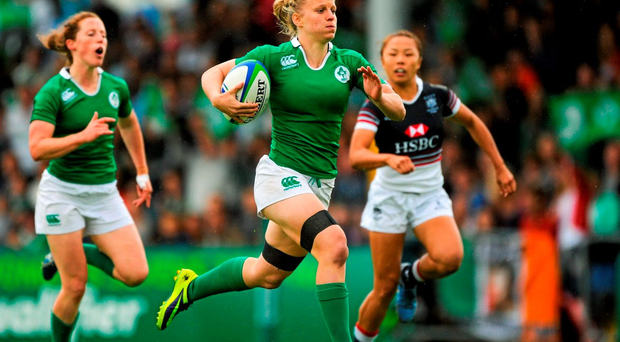 Ireland's Claire Molloy sprints clear to score a try against Hong Kong yesterday