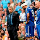 Chelsea's Diego Costa wears a bandage next to manager Jose Mourinho