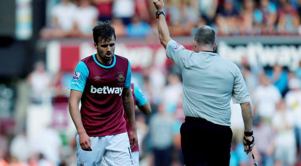 West Ham United's on-loan right back Carl Jenkinson sees red for bringing down former Leeds United winger Max Gradel in the box