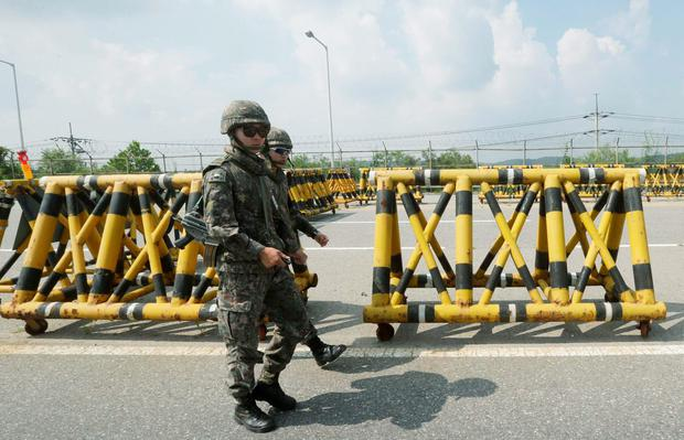 South Korean amy soldiers patrol on Unification Bridge, which leads to the demilitarized zone, near the border village of Panmunjom in Paju, South Korea, Saturday, Aug. 22, 2015. (AP Photo/Ahn Young-joon)