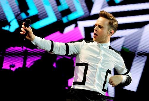 Olly Murs performs on the MTV stage during day one of the V Festival, at Hylands Park in Chelmsford, Essex. PRESS ASSOCIATION Photo. Picture date: Saturday August 22, 2015. Photo credit should read: Nick Ansell/PA Wire