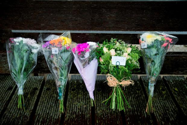 Flowers laid on the Shoreham Tollbridge that crosses the River Adur near the site where seven people died when an historic Hawker Hunter fighter jet plummeted on to the A27 at Shoreham in West Sussex after failing to pull out of a loop manoeuvre Credit: Daniel Leal-Olivas/PA Wire