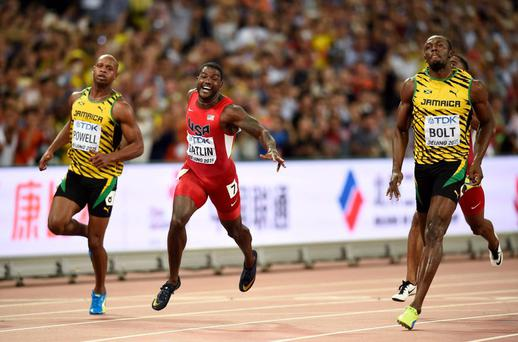 Usain Bolt of Jamaica crosses the finish line first to win the men's 100 metres final at the 15th IAAF World Championships at the National Stadium in Beijing
