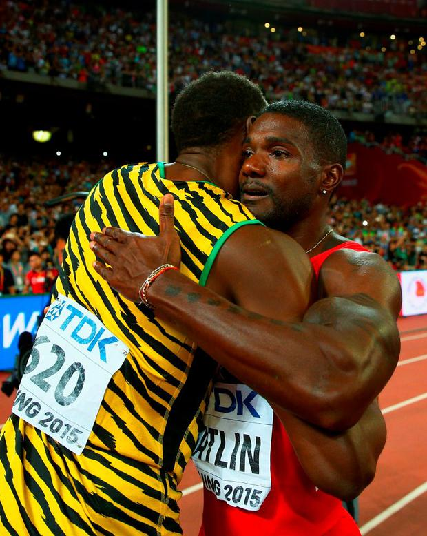 Usain Bolt of Jamaica celebrates is congratulated by Justin Gatlin of the United States after winning gold in the Men's 100 metres final during day two of the 15th IAAF World Athletics Championships Beijing 2015 at Beijing National Stadium on August 23, 2015 in Beijing, China. (Photo by Ian Walton/Getty Images)