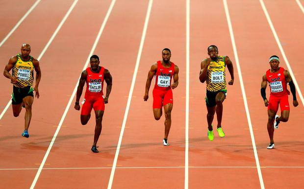 (L-R) Asafa Powell of Jamaica, Justin Gatlin of the United States, Tyson Gay of the United States, Usain Bolt of Jamaica and Mike Rodgers of the United States cross the finish line in the Men's 100 metres final during day two of the 15th IAAF World Athletics Championships Beijing 2015 at Beijing National Stadium on August 23, 2015 in Beijing, China. (Photo by Michael Steele/Getty Images)