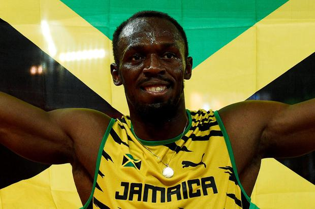Jamaica's Usain Bolt celebrates winning the final of the men's 100 metres athletics event at the 2015 IAAF World Championships at the