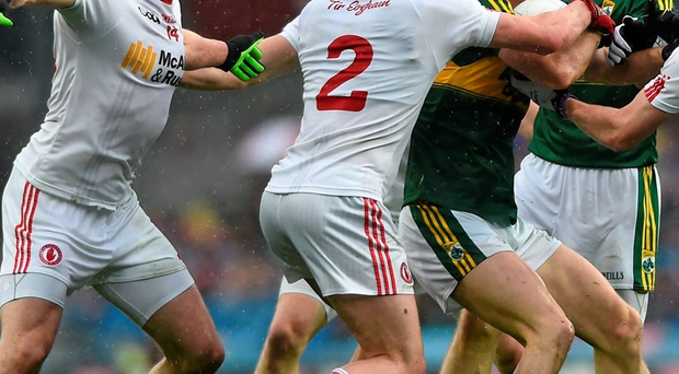 Kerry's Jonathan Lyne under pressure from Tyrone players in the All-Ireland semi-final