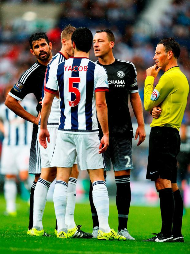 Diego Costa and John Terry of Chelsea talk with Claudio Yacob of West Bromwich Albion and referee Mark Clattenburg during the Barclays Premier League match between West Bromwich Albion and Chelsea