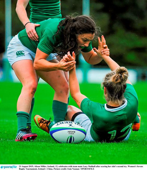 Alison Miller, Ireland, 12, celebrates with team mate Lucy Mulhall after scoring her side's second try. Women's Sevens Rugby Tournament, Ireland v China. Picture credit: Eoin Noonan / SPORTSFILE