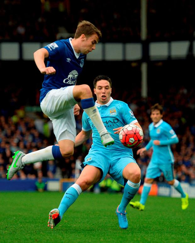 Everton's Irish defender Seamus Coleman (L) controls the ball by Manchester City's French midfielder Samir Nasri during the English Premier League football match between Everton and Manchester City at Goodison Park in Liverpool on August 23, 2015. AFP PHOTO / OLI SCARFF