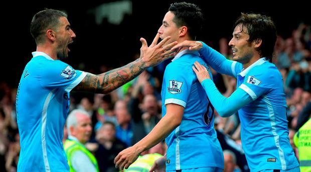 Samir Nasri (C) of Manchester City celebrates scoring his team's second goal with Aleksandar Kolarov (L) and David Silva during the Barclays Premier League match between Everton and Manchester City at Goodison Park on August 23, 2015 in Liverpool, England. (Photo by Alex Livesey/Getty Images)