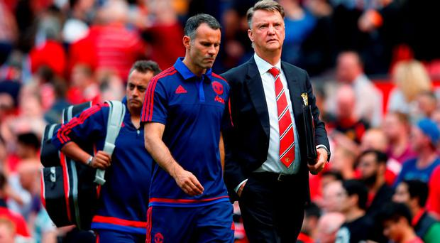 Louis van Gaal Manager of Manchester United and coach Ryan Giggs leave the pitch after their team's 0-0 draw in the Barclays Premier League match between Manchester United and Newcastle United at Old Trafford