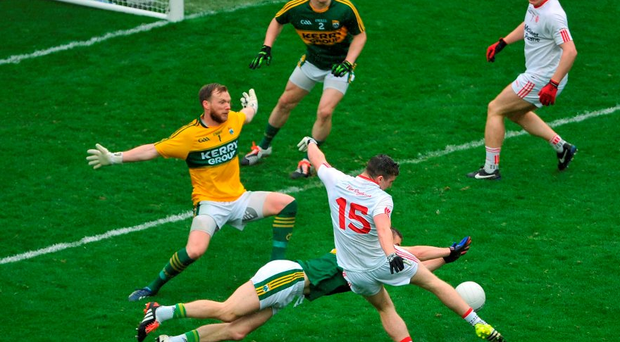 Tyrone's Connor McAliskey has his goal-bound shot blocked by Kerry's Marc Ó Sé