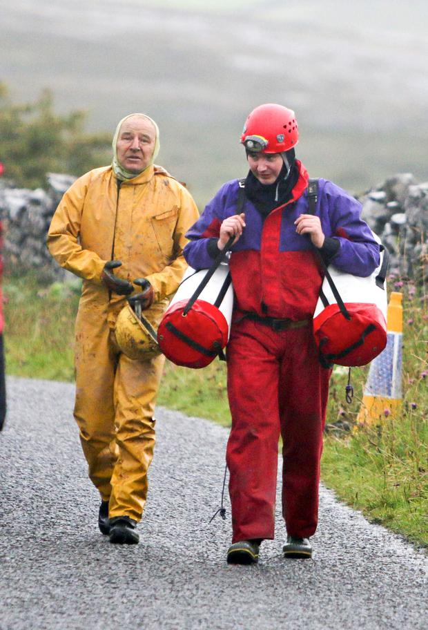 Patrick Troy (left) and one of his rescuers after he and his son Finn were rescued from a cave in north Clare yesterday after being stuck for 28 hours Picture Credit Press 22