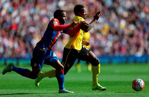 Adama Traore of Aston Villa and Jason Puncheon of Crystal Palace compete for the ball