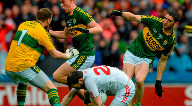 Barry Tierney, Tyrone, being taken down for his side's penalty with Brendan Kealy, Fionn Fitzgerald and Killian Young, Kerry, surrounding him. GAA Football All-Ireland Senior Championship, Semi-Final, Kerry v Tyrone. Croke Park, Dublin. Picture credit: Oliver McVeigh / SPORTSFILE