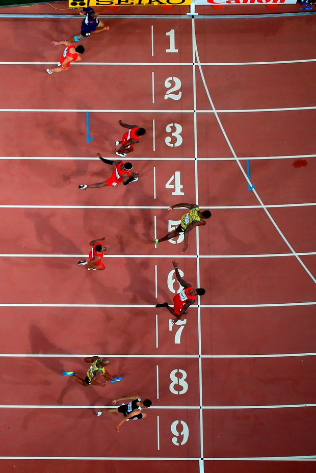 Usain Bolt pips Justin Gatlin to win the 100 title in Beijing