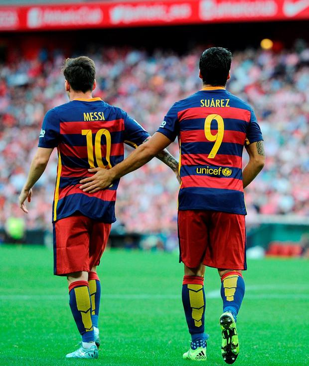 Luis Suarez of FC Barcelona celebrates with Lionel Messi after scoring Barcelona opening goal during the La Liga match between Athletic Club and FC Barcelona at San Mames Stadium on August 23, 2015 in Bilbao, Spain. (Photo by Denis Doyle/Getty Images)