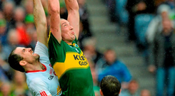 Kerry's Kieran Donaghy battles for the ball with Tyrone's Justin McMahon