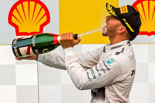 Lewis Hamilton celebrates after winning yesterday's Belgian Grand Prix