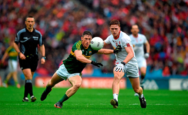 Kerry's Jonathan Lyne battles for possession with Tyrone's Conor Meyler