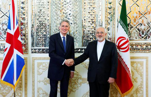 Iranian foreign minister Mohammad Javad Zarif, right, and British foreign secretary Philip Hammond in Tehran