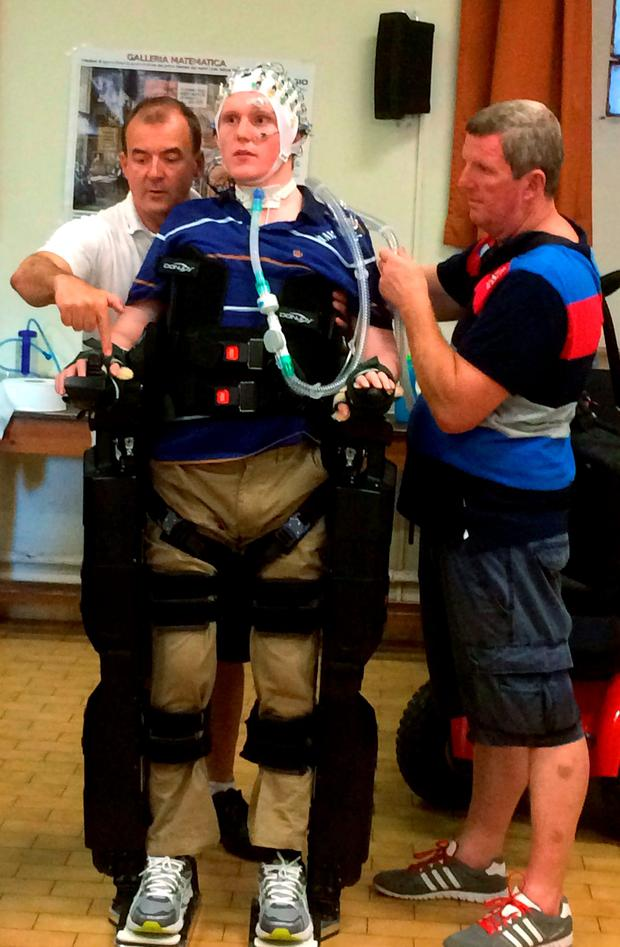 Rob Camm trying out an electronic robotic exoskeleton at the Robotics Science and Systems Conference in Rome. University of Bristol /PA Wire