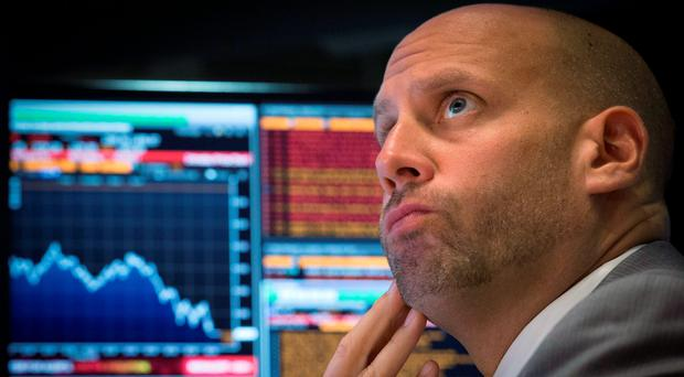 A trader works on the floor of the New York Stock Exchange August 24, 2015. Photo: REUTERS/Brendan McDermid