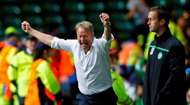 Malmo coach Age Hareide celebrates after Jo Inge Berget scored their second goal in the first leg against Celtic