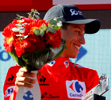 Esteban Chaves Rubio celebrates his red jersey on the podium of the third stage of the 2015 Vuelta Espana cycling tour