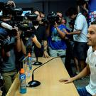 Barcelona's former forward Pedro Rodriguez sits during a farewell press conference for his departure from the club to English football team Chelsea at the Sports Center FC Barcelona Joan Gamper in Sant Joan Despi, near Barcelona on August 24, 2015