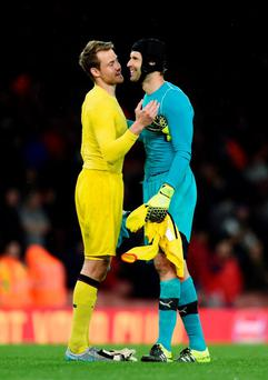 Arsenal's Petr Cech with Liverpool's Simon Mignolet at full time