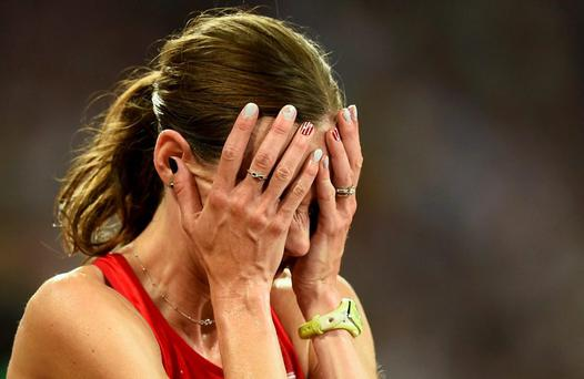 Molly Huddle of the U.S. reacts after finishing the women's 10,000 metres final during the15th IAAF World Championships at the National Stadium in Beijing