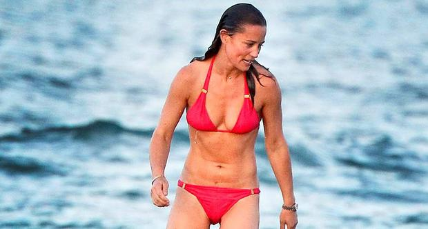 Pippa Middleton's its the water in a red bikini on holiday in St Bart's. Picture: Splash News