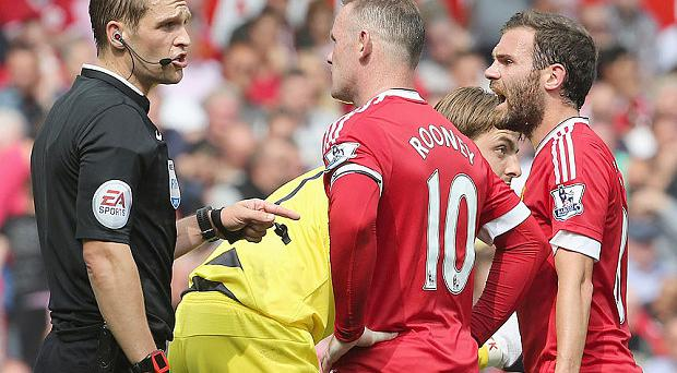 Failing to gel: Wayne Rooney and Juan Mata are yet to click on the pitch