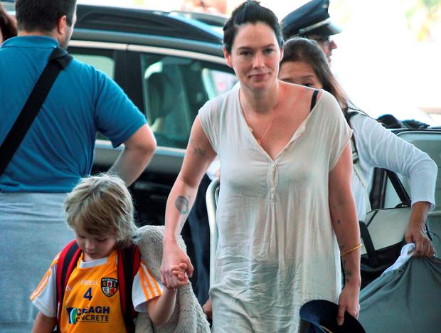 Game Of Thrones star Lena Headey at LAX with her son Wylie in an Antrim jersey.