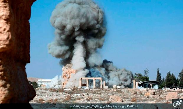 This undated photo released Tuesday, Aug. 25, 2015 on a social media site used by Islamic State militants, which has been verified and is consistent with other AP reporting, shows smoke from the detonation of the 2,000-year-old temple of Baalshamin in Syria's ancient caravan city of Palmyra. (Islamic State social media account via AP)