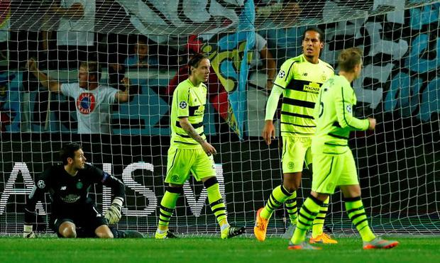 Celtic's Virgil van Dijk and team mates look dejected after Dedryck Boyata (hidden) scored an own goal and the second for Malmo Action Images via Reuters / Andrew Boyers Livepic EDITORIAL USE ONLY.
