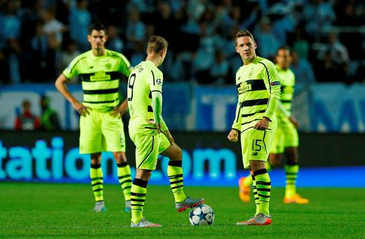 Celtic's Leigh Griffiths and Kris Commons look dejected after Dedryck Boyata (not pictured) scored an own goal and the second for Malmo Action Images via Reuters / Andrew Boyers Livepic EDITORIAL USE ONLY.