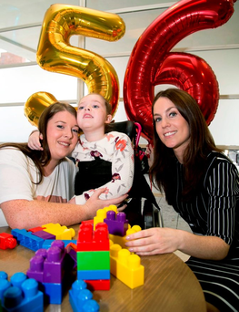 Lisa Cawley with her daughter Erika and Caroline Donnellan, of KBC, at the announcement yesterday Photo: Colm Mahady