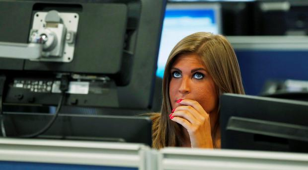 A risk manager studies the markets on the trading floor at the IG Index in London yesterday