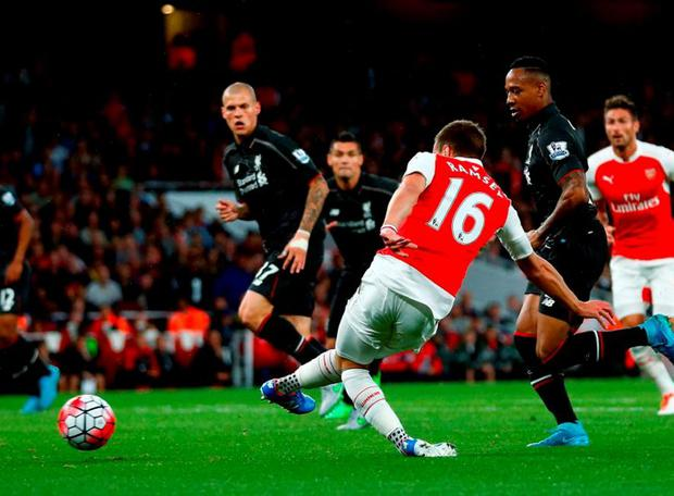 Aaron Ramsey of Arsenal scores a goal disallowed for offside during the Barclays Premier League match between Arsenal and Liverpool