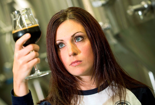 Chrissy Kearns, from White Hag Brewery, samples some beer at the company's plant in Ballymote, Co Sligo